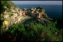 Harbor, church, 11th century castle and village, late afternoon, Vernazza. Cinque Terre, Liguria, Italy (color)