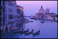 Gondolas, Grand Canal, Santa Maria della Salute church from the Academy Bridge,  sunset. Venice, Veneto, Italy (color)