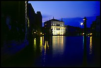 Grand Canal at night with lighted palace. Venice, Veneto, Italy