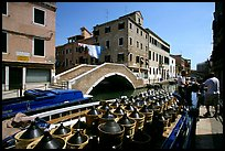 Delivery of wine along a side canal, Castello. Venice, Veneto, Italy (color)