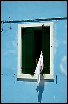 Laundry hanging from a window, Burano. Venice, Veneto, Italy