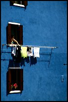 Windows, hanging laundry, blue house, Burano. Venice, Veneto, Italy