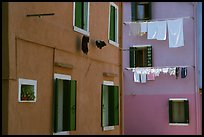 Multicolored houses and hanging laundry, Burano. Venice, Veneto, Italy (color)