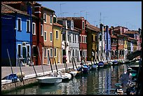 Canal lined with typical brightly painted houses, Burano. Venice, Veneto, Italy