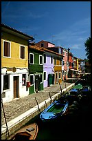 Canal lined with houses painted with bright colors, Burano. Venice, Veneto, Italy