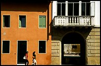 House facades with women walking. Veneto, Italy ( color)