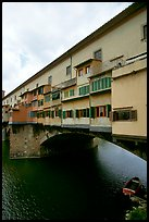 Ponte Vecchio bridge covered with shops, spanning  Arno River. Florence, Tuscany, Italy ( color)