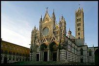 Siena Cathedral (Duomo) with bands of colored marble, late afternoon. Siena, Tuscany, Italy ( color)