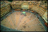Medieval Piazza Del Campo with paving divided into nine sectors to represent Council of Nine.. Siena, Tuscany, Italy ( color)