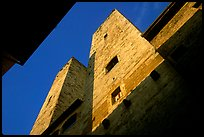 Medieval tower seen from the street, early morning. San Gimignano, Tuscany, Italy ( color)