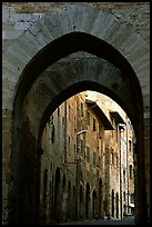 Arch and street. San Gimignano, Tuscany, Italy ( color)