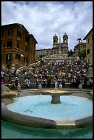 Fontana della Barcaccia and Spanish Steps covered with tourists sitting. Rome, Lazio, Italy
