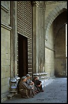 Nuns sit outside of one of  many churches of the historic town. Naples, Campania, Italy ( color)