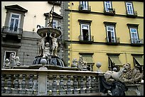Fountain with man at balcony in background. Naples, Campania, Italy ( color)