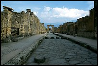 Street with roman period pavement and sidewalks. Pompeii, Campania, Italy