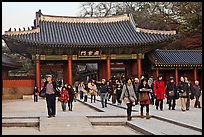 People walking down gate, Changdeok Palace. Seoul, South Korea