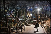 Couple walking down Namsan stairs by night. Seoul, South Korea ( color)