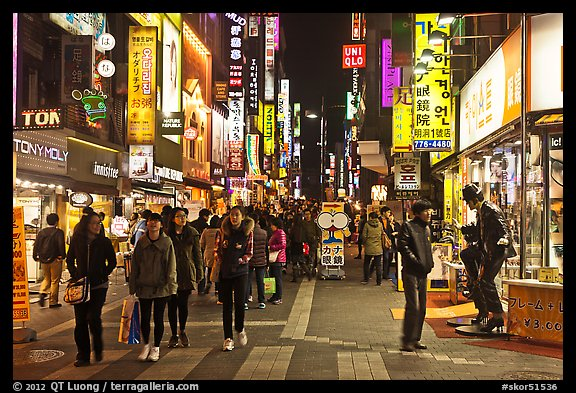 Shoppers on pedestrian street by night. Seoul, South Korea (color)