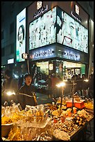 Street food vendor and cosmetics store by night. Seoul, South Korea (color)