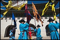 Guards carrying flags in front of main gate, Gyeongbokgung. Seoul, South Korea