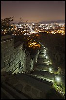 Path, wall, and city lights, Suwon Hwaseong Fortress. South Korea ( color)