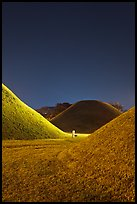 Grassy burial tumulus at night. Gyeongju, South Korea (color)
