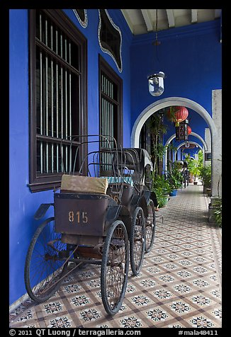 Rickshaws in front gallery, Cheong Fatt Tze Mansion. George Town, Penang, Malaysia (color)