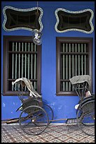 Rickshaws and windows, Cheong Fatt Tze Mansion. George Town, Penang, Malaysia