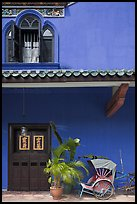 Window, door, and trishaw, Cheong Fatt Tze Mansion. George Town, Penang, Malaysia