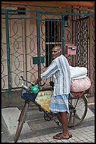 Malay with loaded bicycle. George Town, Penang, Malaysia