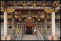 Women standing at Khoo Kongsi entrance. George Town, Penang, Malaysia (color)