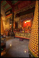 Altar and wheels in motion, Hainan Temple. George Town, Penang, Malaysia