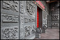 Carved stone walls, Hainan Temple. George Town, Penang, Malaysia (color)