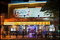 Movie theater showing Bollywood films at night. George Town, Penang, Malaysia (color)