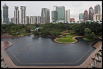 KLCC Park surrounded by high-rise towers. Kuala Lumpur, Malaysia (color)