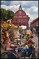 Malacca Town Square with trishaws and church. Malacca City, Malaysia