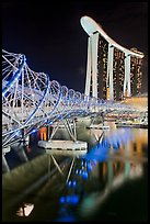 Helix Bridge and Marina Bay Sands hotel at night. Singapore ( color)