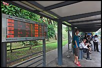 Bus stop with displays with expected wait time. Singapore ( color)