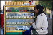 Woman selling dairy desserts on the street. Guadalajara, Jalisco, Mexico (color)