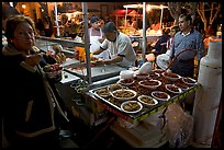 Woman eating by a street food stand , Tlaquepaque. Jalisco, Mexico (color)
