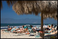 People lying on beach chairs, Nuevo Vallarta, Nayarit. Jalisco, Mexico ( color)