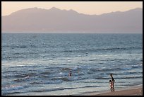 Woman holding children on the beach at sunset, Nuevo Vallarta, Nayarit. Jalisco, Mexico