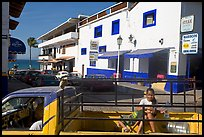 Girl riding in the back of pick-up truck in a street close to ocean, Puerto Vallarta, Jalisco. Jalisco, Mexico ( color)