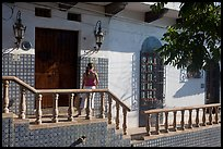 Woman waiting at the door of a house, Puerto Vallarta, Jalisco. Jalisco, Mexico ( color)