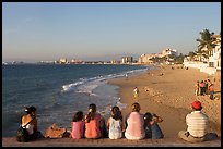 Family sitting above the beach, late afternoon, Puerto Vallarta, Jalisco. Jalisco, Mexico ( color)