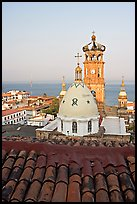 Red tile roof, Templo de Guadalupe Cathedral, and ocean early morning, Puerto Vallarta, Jalisco. Jalisco, Mexico