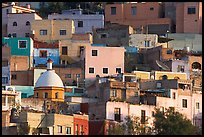 Multicolored houses on a steep hillside, late afternoon. Guanajuato, Mexico ( color)