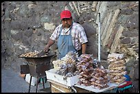 Man selling grilled peanuts on the street. Guanajuato, Mexico