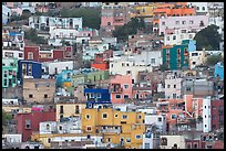 Steep hill with multicolored houses. Guanajuato, Mexico (color)