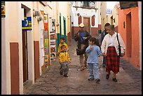 Family walking down an alley. Guanajuato, Mexico (color)